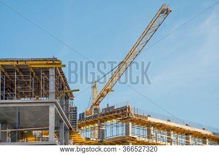 Construction Crane Near New Built House. Construction And Developing Horizontal Photo