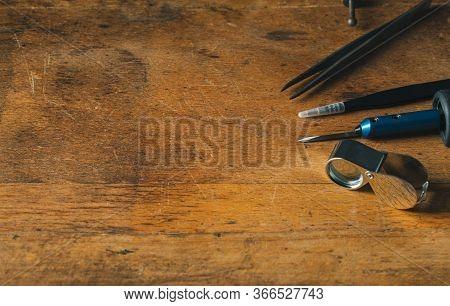 Jewelry Craftsmanship. Handmade. Jeweler At Work. The Jeweller Engraver Tools On Wooden Vintage Desk