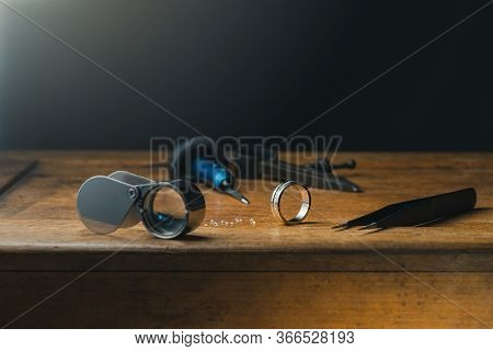 Jeweller Engraver Tools And Golden Ring. Side View Copy Free Space On Top