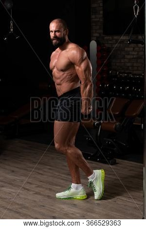 Handsome Bodybuilder Making Side Triceps Pose