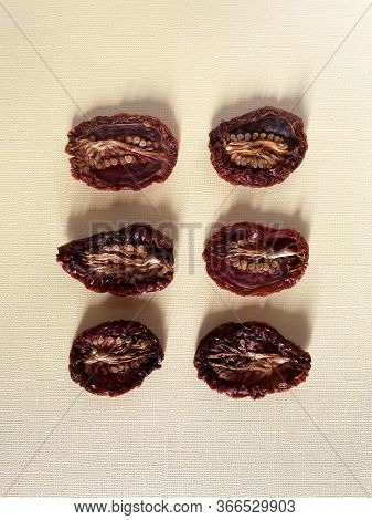 Sundried Or Dried Tomato Halves, Top View, Different Shapes And Sizes, Seeds Up.