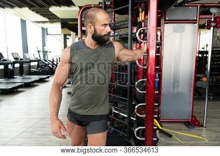 Athletic Man Stretches