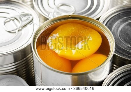 Canned Peaches In Just Opened Tin Can. Non-perishable Food