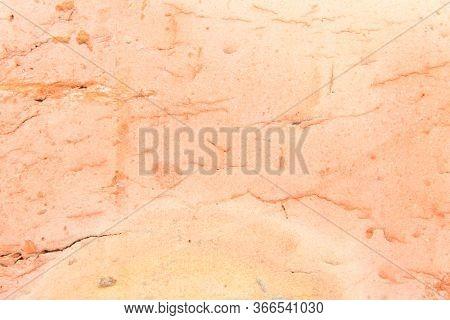 A Closeup Photo Of A Brick. Orange Background.