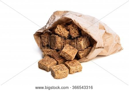 Mini  Oat And Syrup Flapjack Slices In Paper Bag Isolated On White