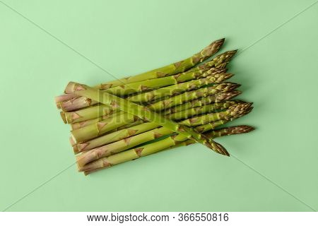 Bunch Of Fresh Raw Green Asparagus Stalks On A Pastel Green Background. Ingredient For Healhy Eating