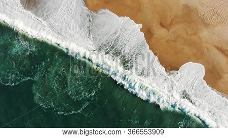 Attractive Upper View Of Turquoise Ocean Washing Golden Sand Beach With Powerful Foamy Waves At Suns