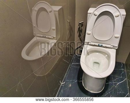 Interior Inside A Restroom, Flush Toilet White In Restroom.