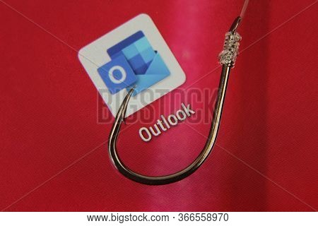 Madrid, Spain- May 10, 2010: Conceptual Picture Emulating Phishing Scam With A Hook On Outlook Icon
