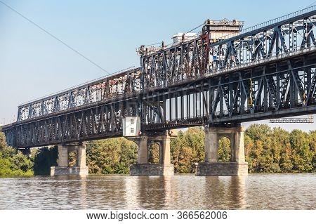 Danube Bridge In Summer. Steel Truss Bridge Over The Danube River Connecting Bulgarian And Romanian