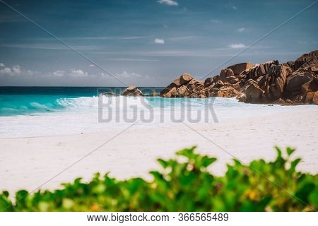 Ocean Foamy Waves And White Sand Beach At Petite Anse, La Digue In Seychelles