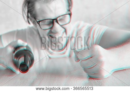 A Drunken Angry Man In Glasses Bangs His Fist On The Table With A Bottle And The Effect Of The Glitc