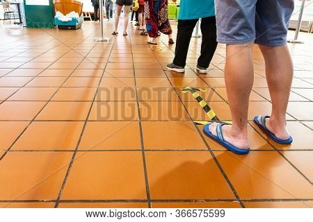 New Normal Social Distancing With Queue In Line Into Supermarket
