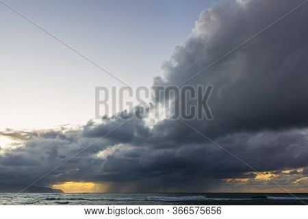 Dark Clouds At Dusk Over The Sea