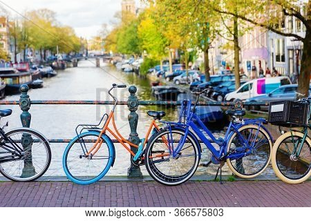 Colorful Bicycle On A Canal Bridge In Amsterdam, Netherlands