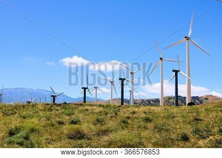 May 16, 2020 In Tehachapi, Ca:  Rows Of Modern Giant And Smaller Wind Turbines At A Wind Farm At A W