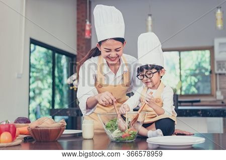Thai Mom And Kid Cooking Together At Home. Social Distancing And Stay Home Stay Safe. Family Activit