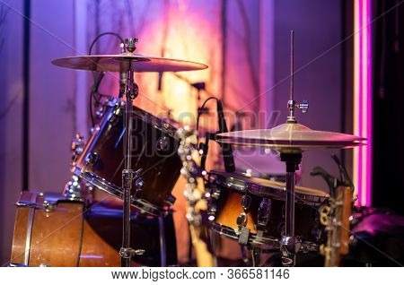 Bright Recording Studio. A Room For Musicians ' Rehearsals, With A Drum Kit In The Background. The C
