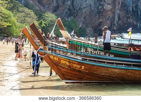 Railay, Thailand - February 15, 2020: Thai Traditional Long Boats On Crowded Phra Nang Cave Beach, R