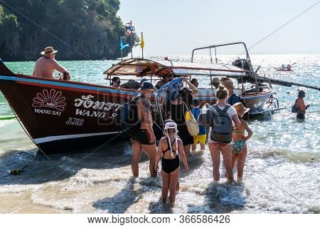 Krabi, Thailand - Feb 15, 2020 : Travelers Getting On Traditional Wooden Long Boat To Travel Around
