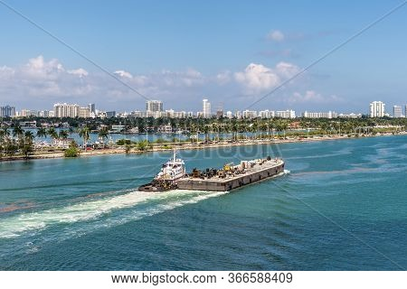 Miami, Fl, United States - April 27, 2019: Tug Boats Helping The Platform To Navigate In Miami Port.