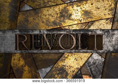 Photo Of Real Authentic Typeset Letters Forming Revolt Text On Vintage Textured Grunge Copper And Bl