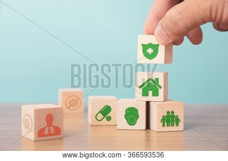 Insurance And Investment Concept Of Health, Life. Hand Picked Wooden Block With Insurance Sign And S