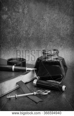 Romantic Old Vintage Still Life Image Of Writing Paraphrenalia Including Fountain Pen Ink Bottle And