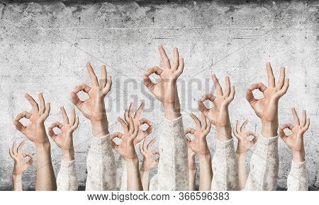 Row Of Man Hands In White Sweater Showing Okay Gesture. Agreement And Approval Group Of Signs. Human