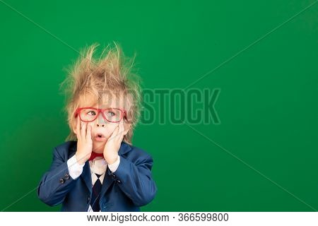 Bright Idea! Surprised Child Student Against Green Chalkboard