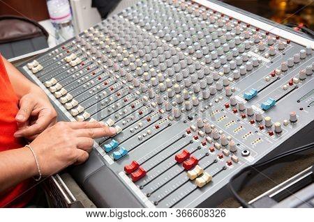 Hand Adjusting Audio Mixer. Sound Engineer Hands Working On Sound Mixer In Live Concert. Dj Controll