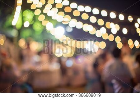 Vintage Tone Blur Image Of Food Stall At Night Festival With Bokeh For Background Usage. Festival Ev