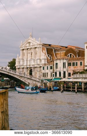 Venice, Italy - 04 October 2019: View From The Water Of The Grand Canal On The Scalzi Bridge And Deg