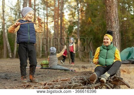 Happy Mother Resting In The Forest With Happy Happy Children, Children Play In A Forest Glade, Campi