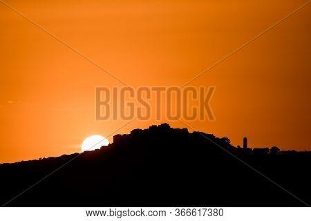Sun Setting Behind Sant'antonino In Corsica