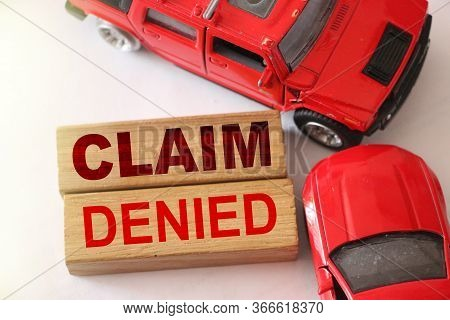 Claim Denied Words On Wooden Blocks And Two Red Cars In Road Accident On White. Insurance Concept, N