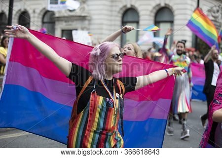 London, Uk - July 6th 2019: A Person Hods A Bisexual Pride Flag At A Gay Pride March In London