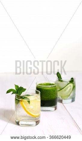 Blended Green Spinach Smoothie And Still Detox Water With Cucumber, Mint And Lemon For Diet Healthy
