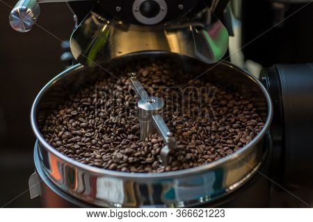 Freshly Roasted Aromatic Coffee Beans In A Modern Coffee Roasting Machine. Fresh Coffee Beans - Fres