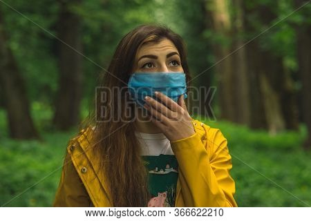 Nature Beauty Female Portrait In Face Mask Health Care Self Protection Tool Restrained Surprise Expr