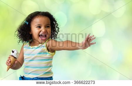 happy kid eating ice cream on green abstract background