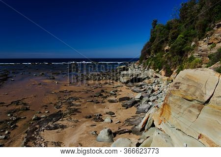 The Rock Shelf At Low Tide At The Southern End Of Shelly Beach On The New South Wales Central Coast