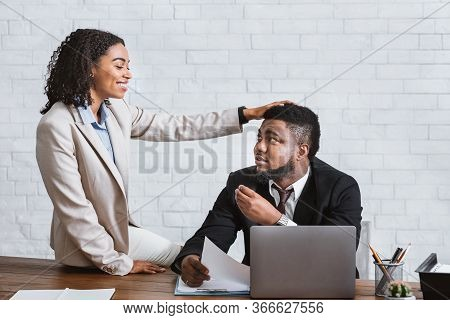 Workplace Molestation Concept. Handsome African American Guy Sexually Harassed By His Female Coworke
