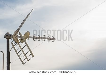 Television Antennas With Sky Background. Analog Television Antenna On Roof. Antennae For Digital Tv