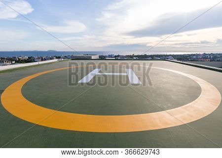 Symbols For Helicopter Parking On The Roof Of An Office Building. Empty Square Front Of City Skyline