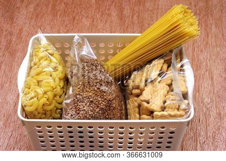 A Donation Box With A Food . Social Assistance With Food. Buckwheat, Spaghetti And Cookies In The Bo