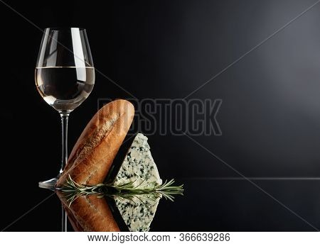 Blue Cheese With Bread, Rosemary And White Wine On A Black Reflective Background. Copy Space For You