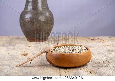 Unpeeled Raw Oats In A Wooden Plate On A Wooden Table