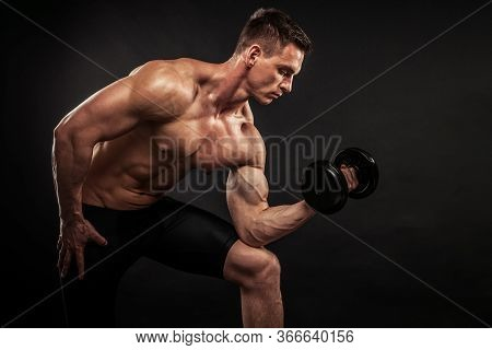 Fitness In Gym, Sport And Healthy Lifestyle Concept. Handsome Athletic Man Showing His Trained Body