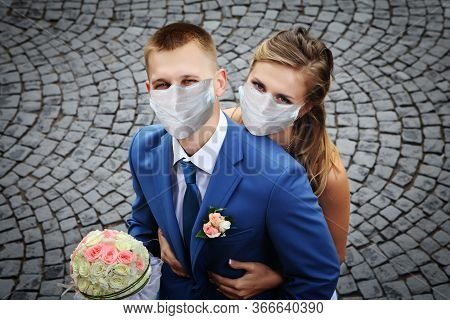 Couple Of Newlyweds Walks In Medical Facial Disposable Masks For Respiratory Protection During The C